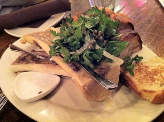 Roasted bone marrow with herb salad and Sicilian sea salt