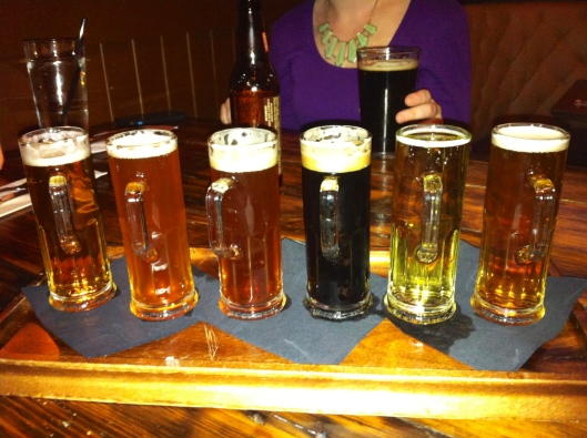 From left to right: Anti-Hero (American IPA), Ten-Ninety Imperial IPA, Hop Head Red (Red Ale), Barney Flats (Oatmeal Stout), Ace Pear (Pear Cider), Brickstone Pale Ale (American Pale Ale)