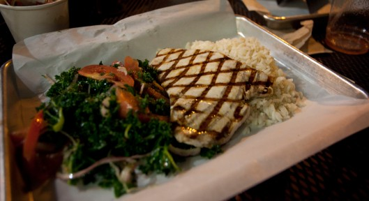 Swordfish with curly kale and tomato salad